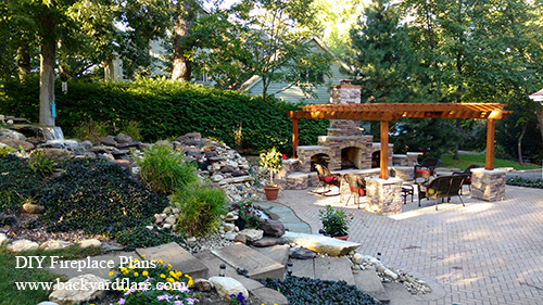 Outdoor Fireplace with storage and seating under pergola